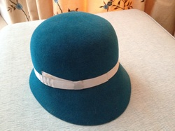 Image of a dark turquoise hat