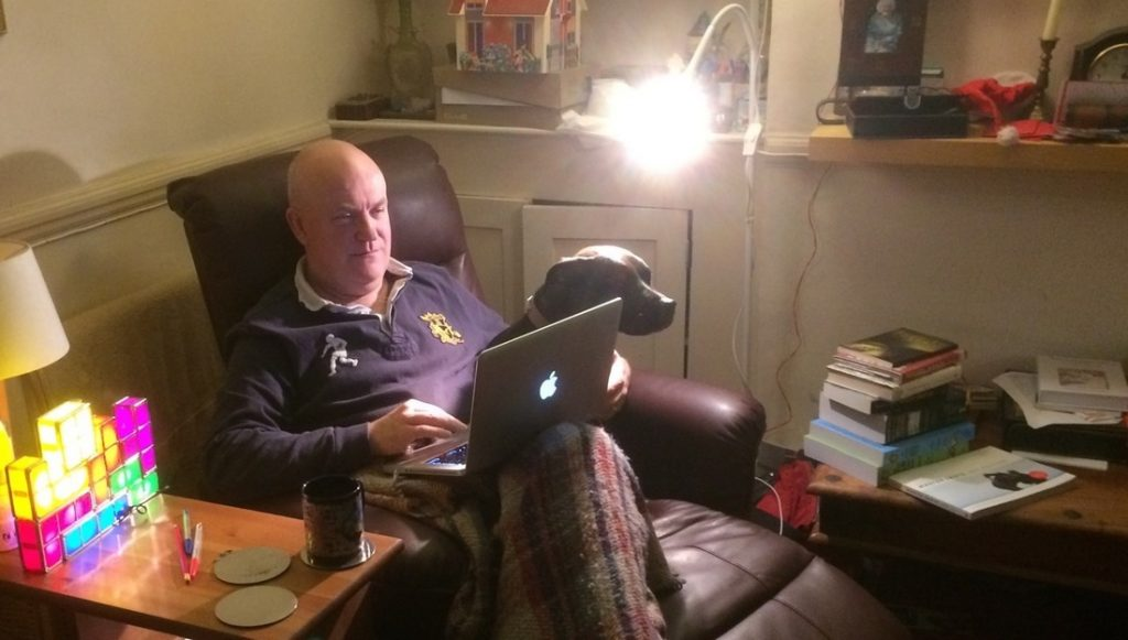 Photo of Nicholas Vince at work in his study