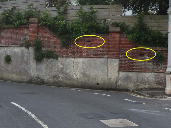Image of Gunhole in wall at Meads Village