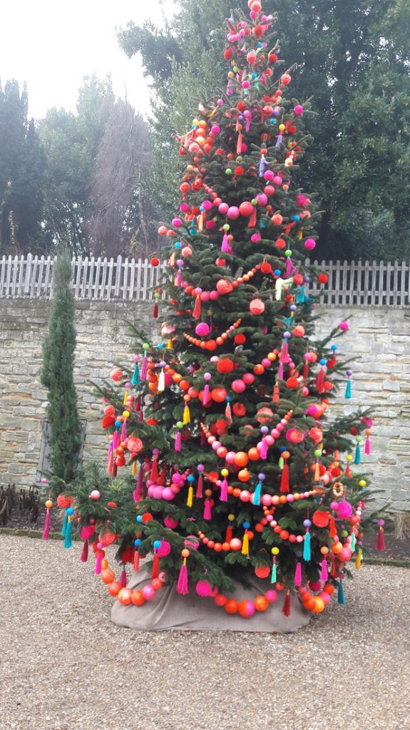 Image of Christmas Tree at Standen with knitted decorations by the textile artist Kaffe Fassett