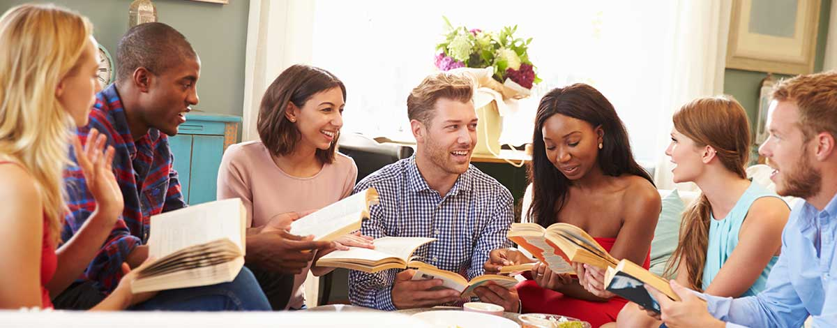 Image of group of people discussing books they have read